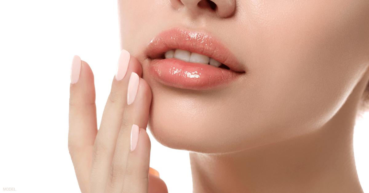 A woman's lips after receiving lip filler.